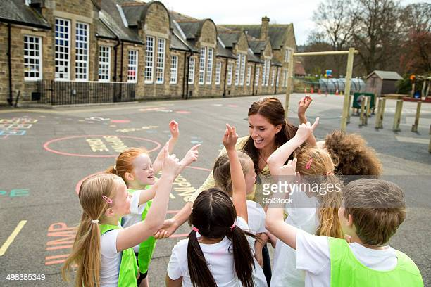 school sports - britain playgrounds stock pictures, royalty-free photos & images