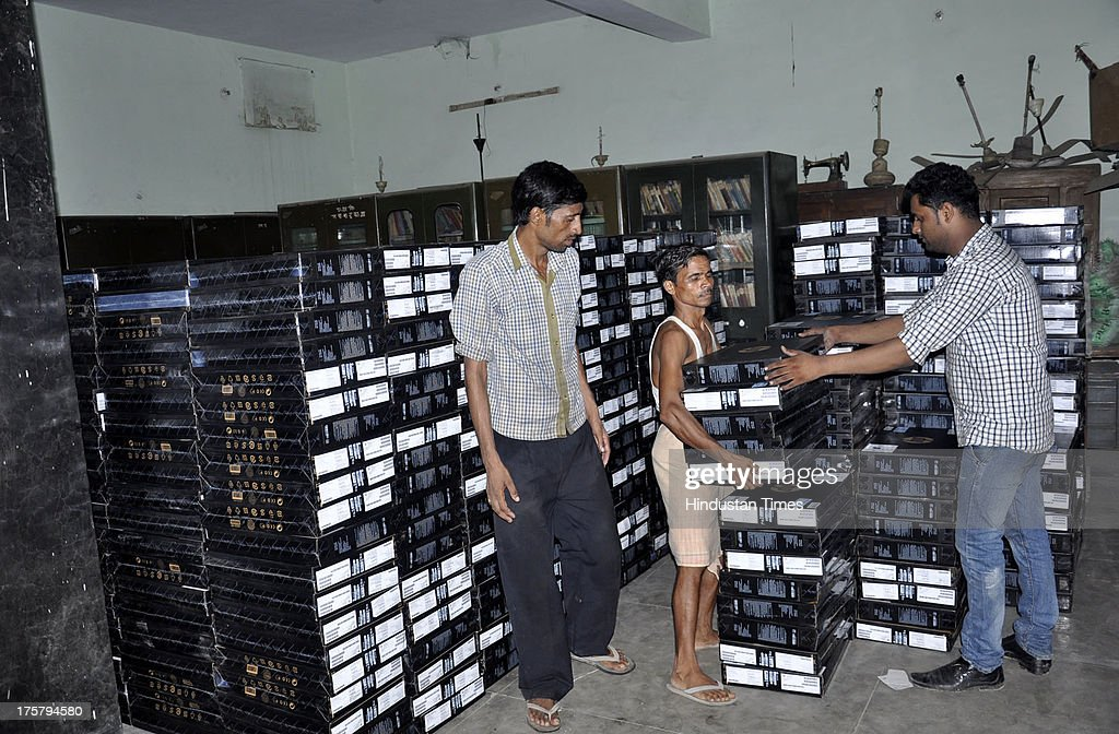 School staff stocking Laptops to be distributed to students in second-phase of distribution on August 8, 2013 in Ghaziabad, India. Around 11,000 new laptops have arrived so far. Samajwadi Party government of Uttar Pradesh is distributing free laptops to the 12th pass students as per its promise made during polls.