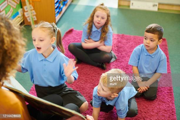school story time - uniform stock pictures, royalty-free photos & images