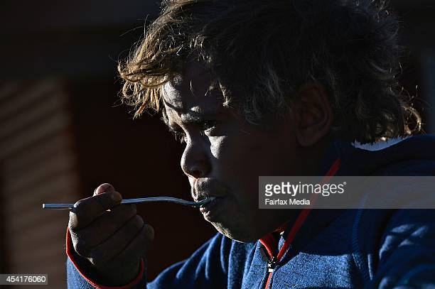 School student Carnett Churchill has breakfast before class in Indulkana Primary School in the Anangu Pitjantjatjara Yankunytjatjara Lands South...