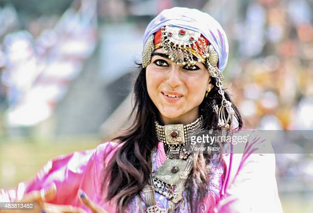 A School student in traditional Kashmiri attire perform during their final full dress rehearsal for the Indian Independence day at Bakshi Stadium...