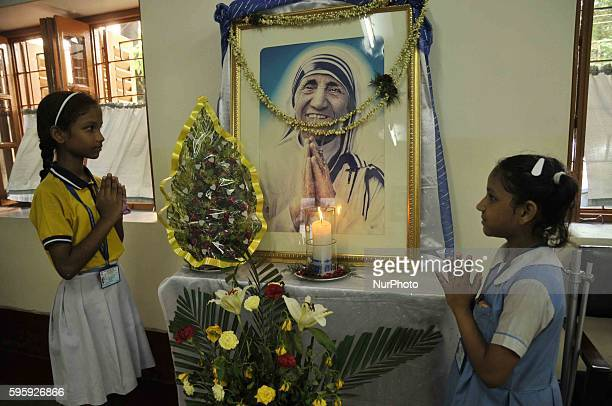 School Student Pray on front of Mother Photographs, Missionaries of Charity celebrate the 106th birthday of Mother Teresa at the Indian Missionaries...