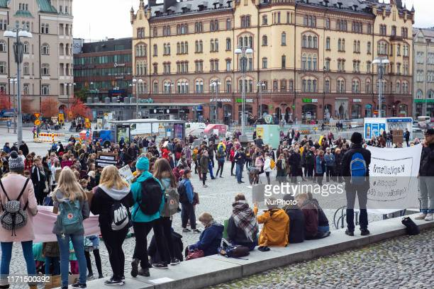 School students and activists take part in the Global Climate Strike in the centre of Tampere, Finland on Friday, September 27, 2019. Many students...