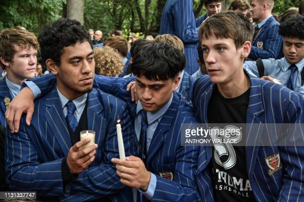 School students attend a vigil in Christchurch on March 18 three days after a shooting incident at two mosques in the city that claimed the lives of...