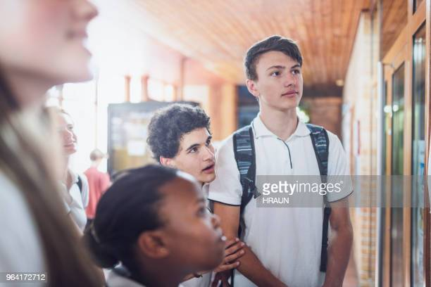 school students checking results on bulletin board - day stock pictures, royalty-free photos & images