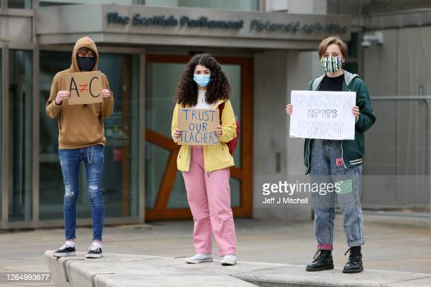 School students demonstrate outside the Scottish Parliament over last week's downgrading of exam results by the Scottish Qualifications Authority on...