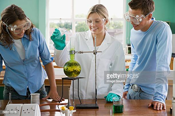 school students doing science experiment - hot high school girls stock photos and pictures