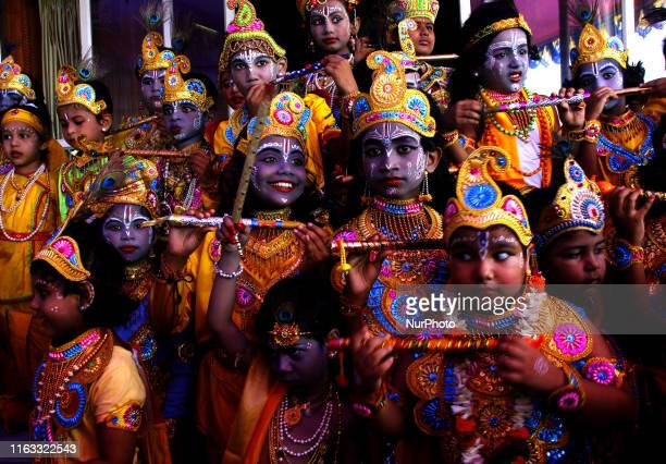 School students dressed as like as Lord Krishna as they participates in a fancy dress competition on the occassion of Lord Krishna's birthday...