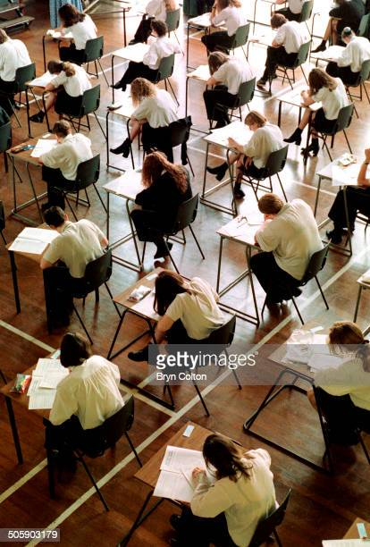 School students from year 11 at Northgate High School sit and take there GCSE English exams while working at temporary desks in the main hall of the...
