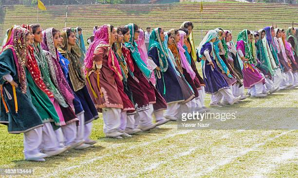 School students in traditional Kashmiri attire perform during their final full dress rehearsal for the Indian Independence day at Bakshi Stadium...