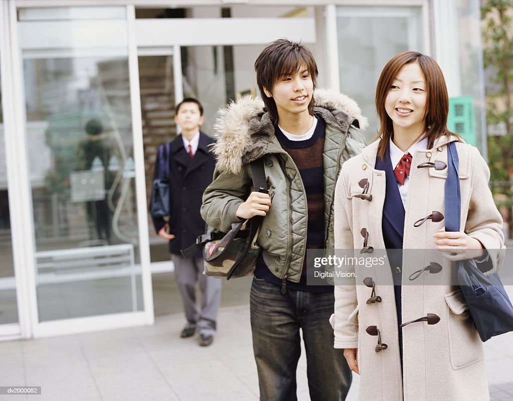 School Students Leaving a School : Stock Photo
