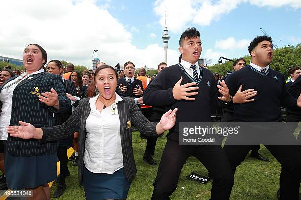 School students perform a haka to welcome the All Blacks during the New Zealand All Blacks welcome home celebrations at Victoria Park on November 4...