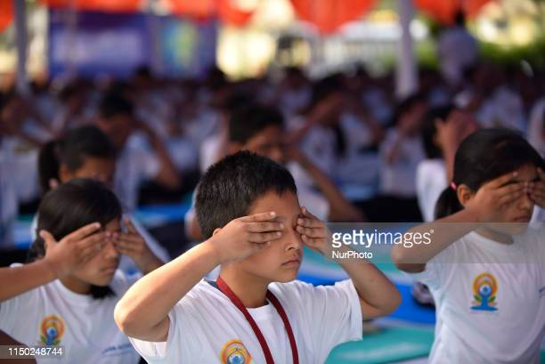 School students performing Yoga Position during the celebration of International Day of Yoga organized by Indian Embassy at Embassy Premises,...
