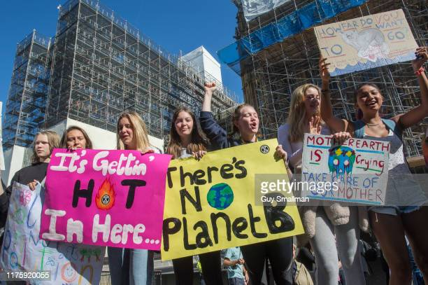 School students protest outside of Parliament on September 20 2019 in London England Millions of people are taking to the streets around the world to...