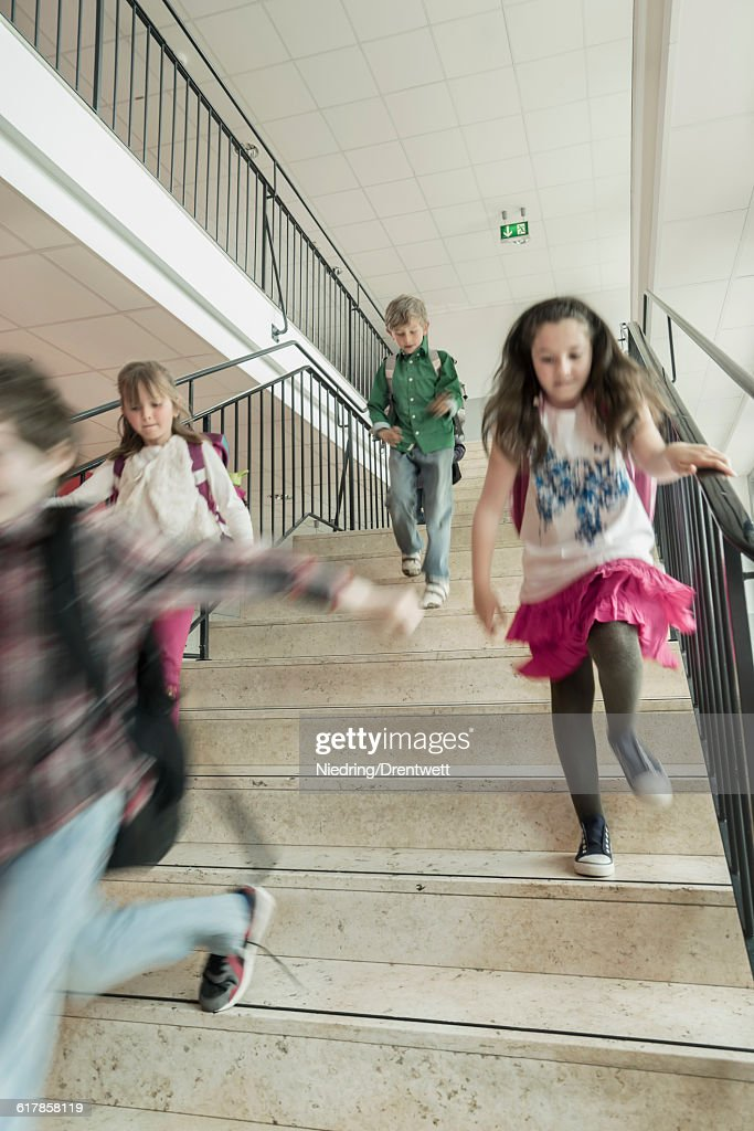 """""""School students running down stairs, Bavaria, Germany"""" : Stock-Foto"""