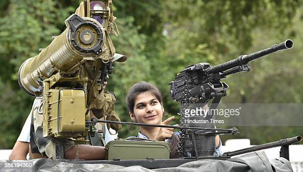 School students showing their interest during the exhibition 'Know Your Army' organized by India Army at Panther Stadium on August 10 2016 in...
