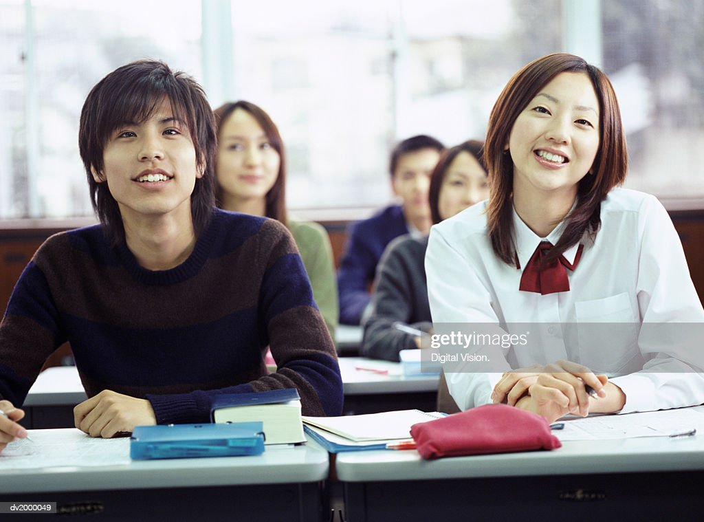School Students Sitting in a Classroom : Stock Photo
