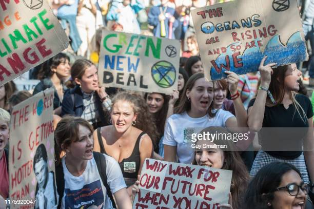 School students stage a sit down protest outside Downing street as part of the global climate strike on September 20 2019 in London England Millions...