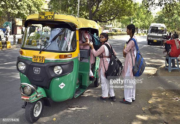 School students try to take an Auto Rickshaw as their school van went out of order at Gole Market on April 18 2016 in New Delhi India Day four of the...