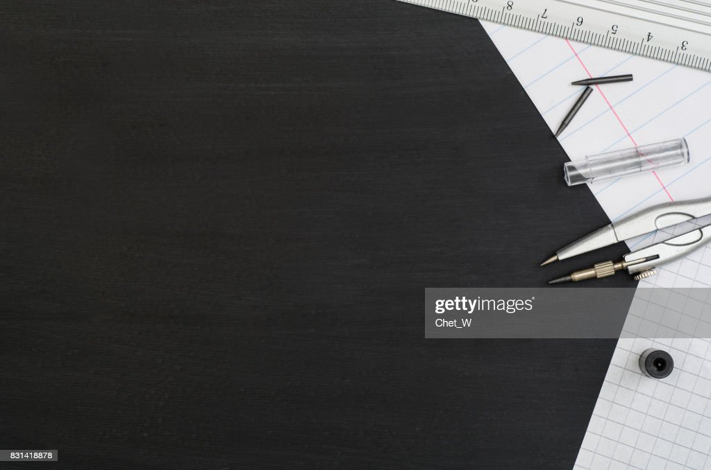 School Supplies Border On Black Chalkboard Background Top View Photograph Stock Photo