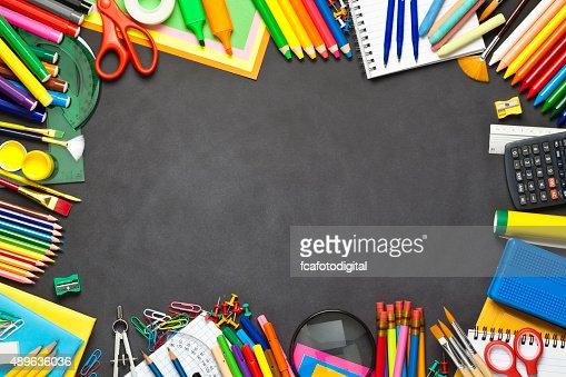 School Supplies Border On Black Chalkboard Stock Photo
