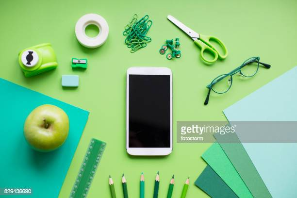 school supplies on green background - personal accessory stock pictures, royalty-free photos & images