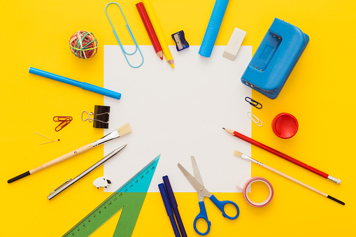 School supplies on yellow desk with copy space.Top view. 582294940