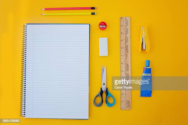 school supplies.yellow background - school supplies stock pictures, royalty-free photos & images