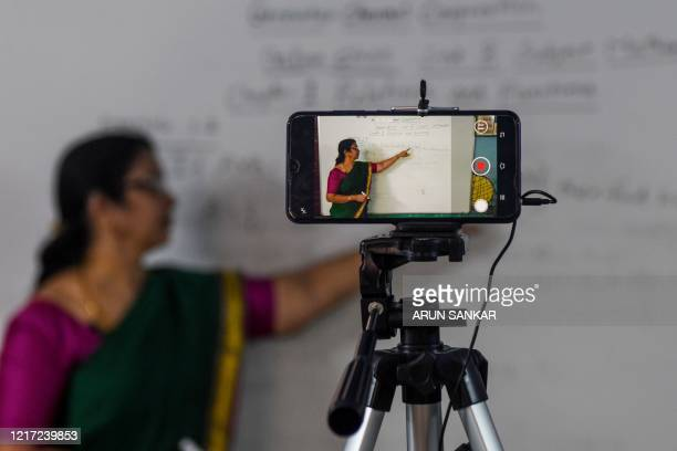School teacher gives a live streaming online class at a government school after the government eased a nationwide lockdown imposed as a preventive...