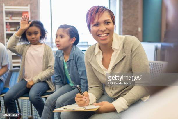 School teacher leads a discussion group