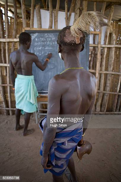 school teacher teaching karo tribesman - hugh sitton ethiopia stock pictures, royalty-free photos & images