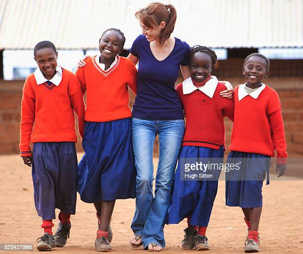 school teacher, walking with a group of school girls, kenya - hugh sitton imagens e fotografias de stock