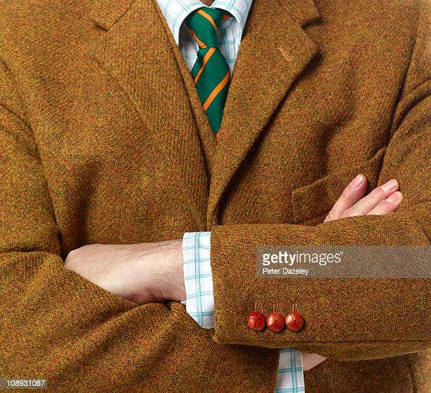 school teacher with arms crossed - brown suit stock photos and pictures