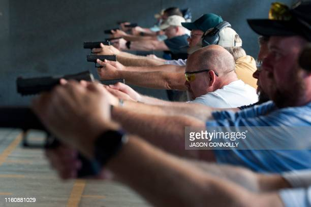 School teachers and administrators fire their guns during the FASTER Level 2 two day firearms course at Flatrock Training Center in Commerce City,...