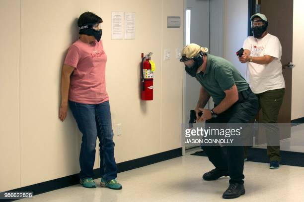 School teachers and administrators participate in an Airsoft mock active shooter drill during a three day firearms course sponsored by FASTER...