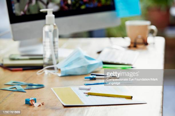 school work on home office desk - education stock pictures, royalty-free photos & images