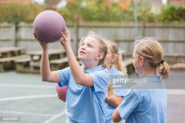 school yard netball sport girls - taking a shot sport stock pictures, royalty-free photos & images