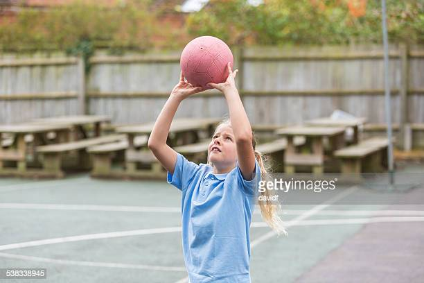 school yard netball sport - taking a shot sport stock pictures, royalty-free photos & images