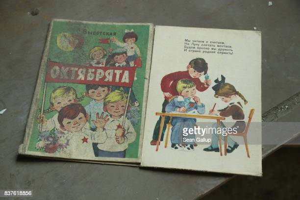 A schoolbook for elementary school children lies in a decaying school in the ghost town of Pripyat not far from the Chernobyl nuclear power plant on...