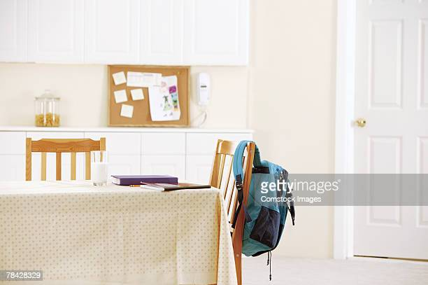schoolbooks and backpack at kitchen table - satchel bag stock photos and pictures