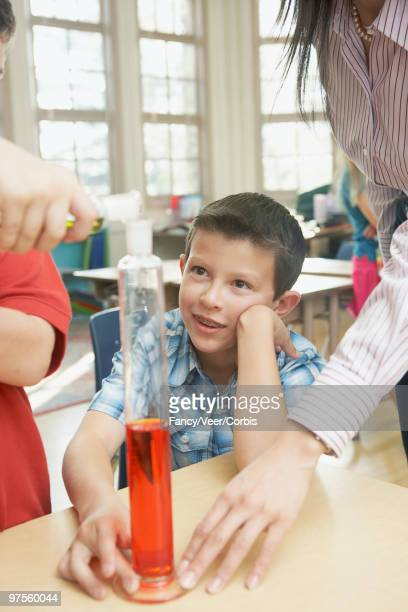 Schoolboy assisting with experiment