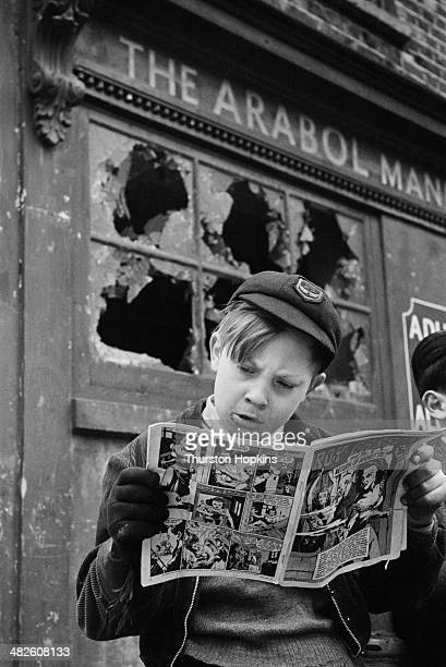 A schoolboy avidly reading the American comic 'Roy Carson' May 1952 Original publication Picture Post 5861 Should US Comics Be Banned pub 17th May...