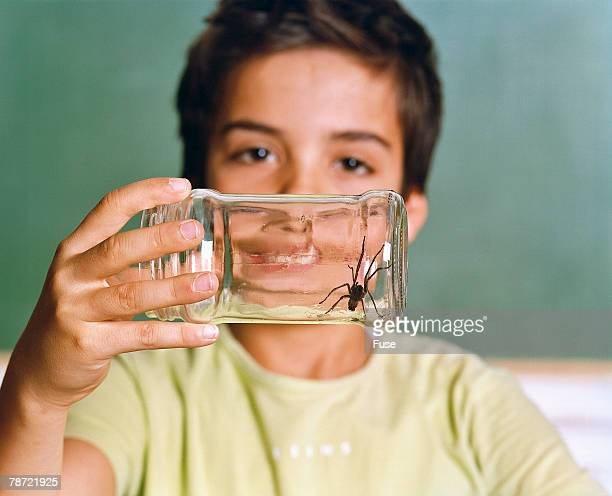 Schoolboy Holding a Jar with Spider