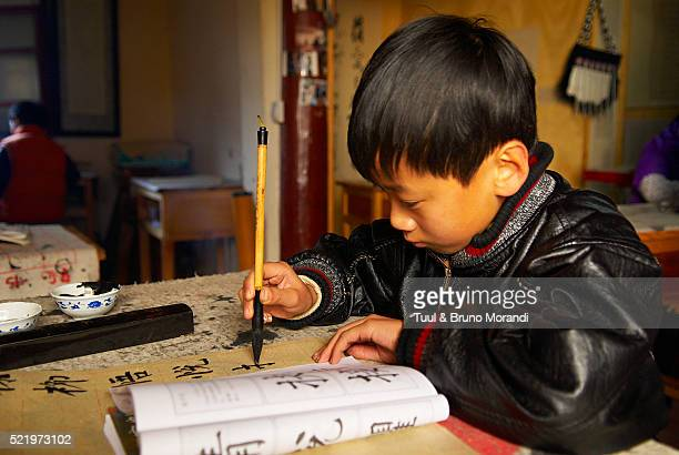Schoolboy in Lijiang, Yunnan, China