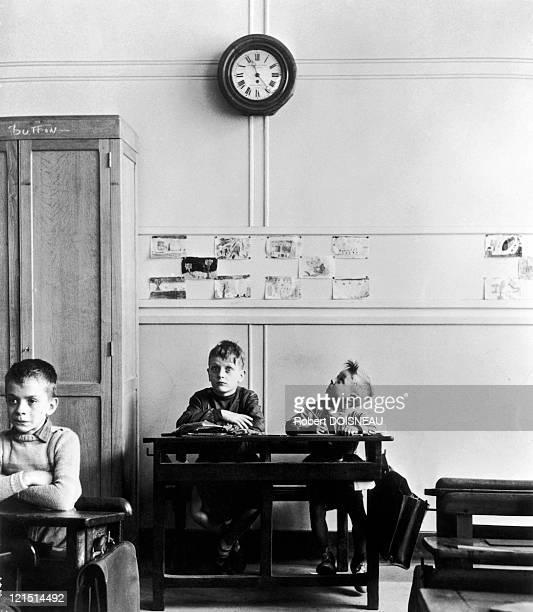 Schoolboy Looking At The Clock In 1956