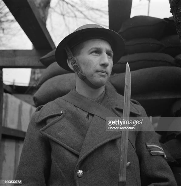 A schoolboy member of the Home Guard on duty during World War II UK March 1941