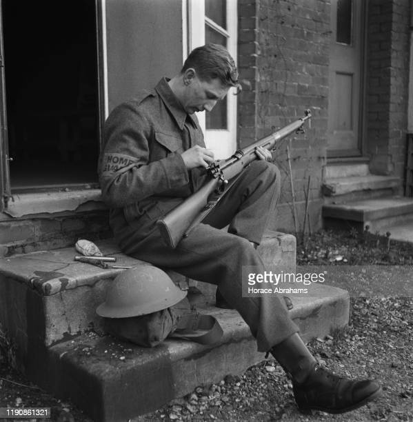 A schoolboy member of the Home Guard on duty with his rifle during World War II UK March 1941