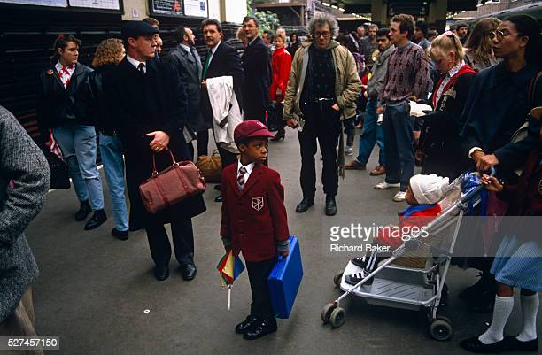 A schoolboy of AfroCaribbean descent stands looking confused on a platform at Victoria mainline station in central London The young lad looks smart...