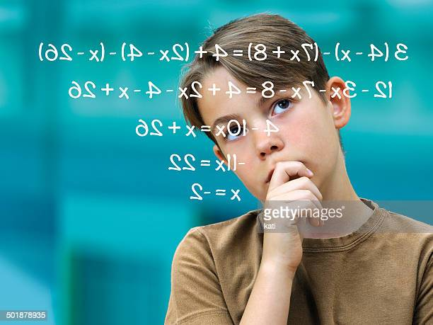 Schoolboy pensively in front of a math problem