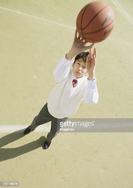 Schoolboy playing basketball